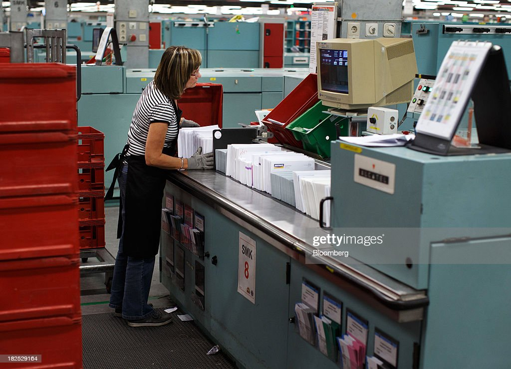 An employee gathers envelopes as mail is sorted at the PostNL NV sorting center in Nieuwegein, Netherlands, on Friday, Sept. 27, 2013. PostNL NV rose the most in two months on Sept. 19 after the Dutch postal operator raised its full-year forecast and announced higher prices for stamps. Photographer: Jasper Juinen/Bloomberg via Getty Images