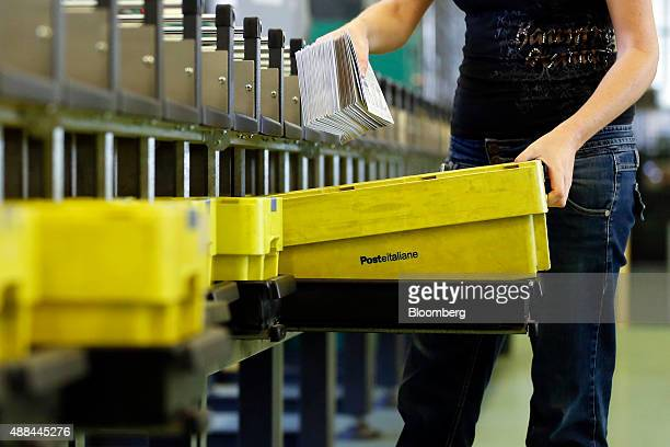 An employee gathers letters by hand inside a Poste Italiane SpA postal sorting office in Fiumicino near Rome Italy on Tuesday Sept 15 2015 Italy is...