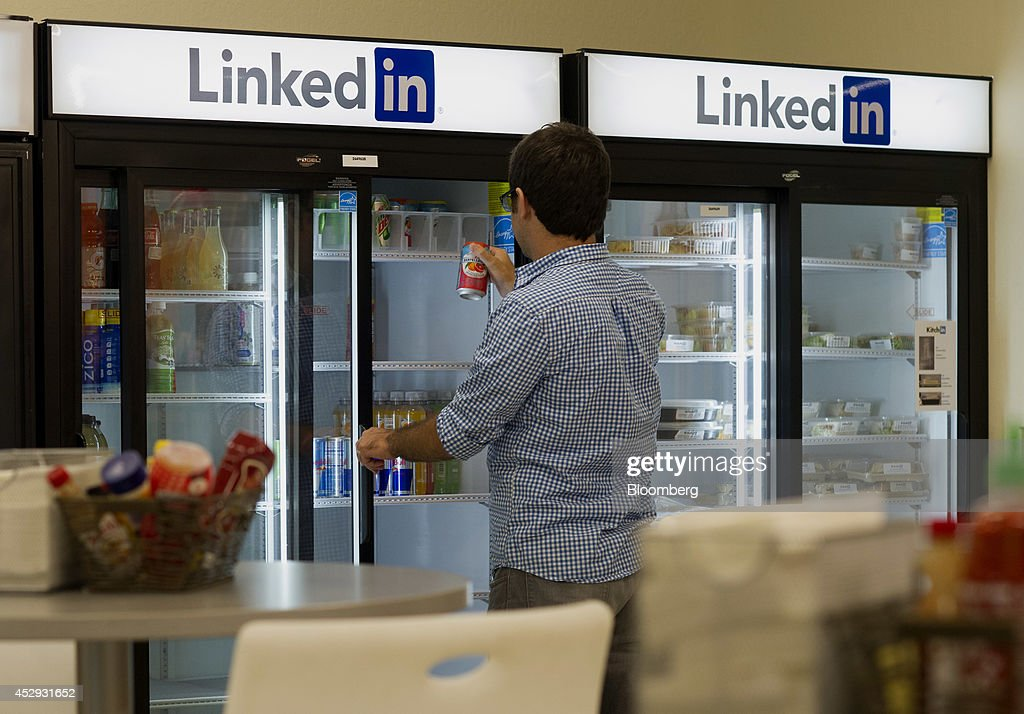 An employee grabs a drink from a cooler at LinkedIn Corp. headquarters in Mountain View, California, U.S., on Monday, July 28, 2014. LinkedIn Corp. is scheduled to release earnings figures on July 31. Photographer: David Paul Morris/Bloomberg via Getty Images