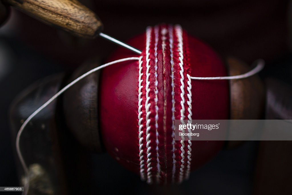 An employee hand stitches the seam of a cricket ball at a Stanford Cricket Industries factory in Meerut, Uttar Pradesh, India, on Wednesday, Jan. 29, 2014. The Indian Premier League (IPL), the worlds richest cricket competition, auction for IPL 2014 is scheduled to begin on Feb. 12 with the seasons first match to be played on April 8. Photographer: Prashanth Vishwanathan/Bloomberg via Getty Images
