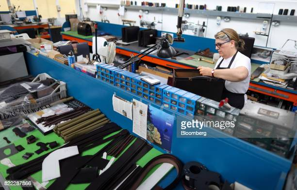 An employee hand stitches the top section of a Wolsley doctors bag at the Alfred Dunhill Ltd London Leather Workshop in London UK on Tuesday July 25...