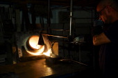 An employee heats a 400 ounce mould before molten gold is poured in during the semiautomated gold bar manufacturing process at a precious metal...