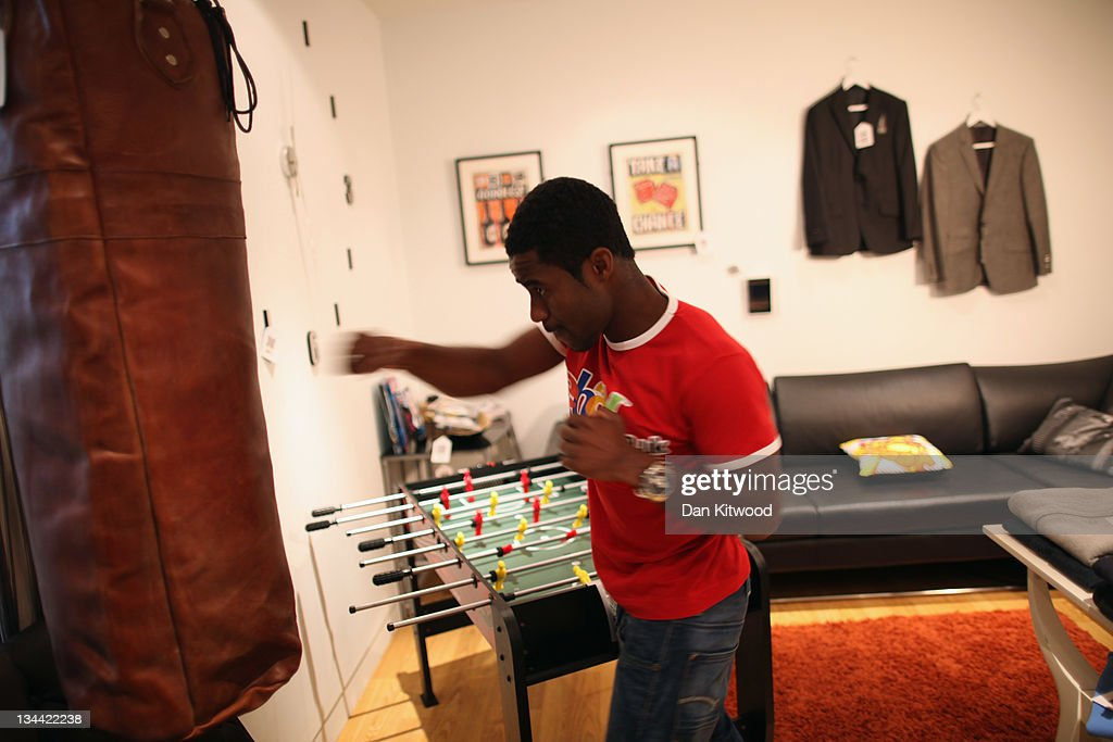 An employee hits a punchbag in the new Ebay store on December 1, 2011 in central London, England. Ebay have launched the first ever quick response code shopping emporium allowing customers to browse in store and then order online using mobile phones and tablets inside the boutique whilst it is open for the next five days.