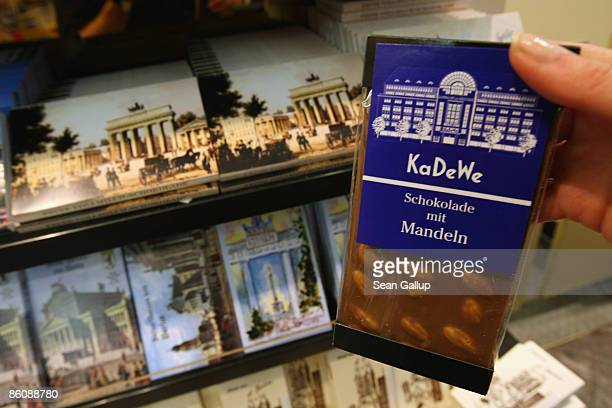 An employee holds a bar of chocolate in this photo illustration at the KaDeWe luxury department store on April 21 2009 in Berlin Germany German...