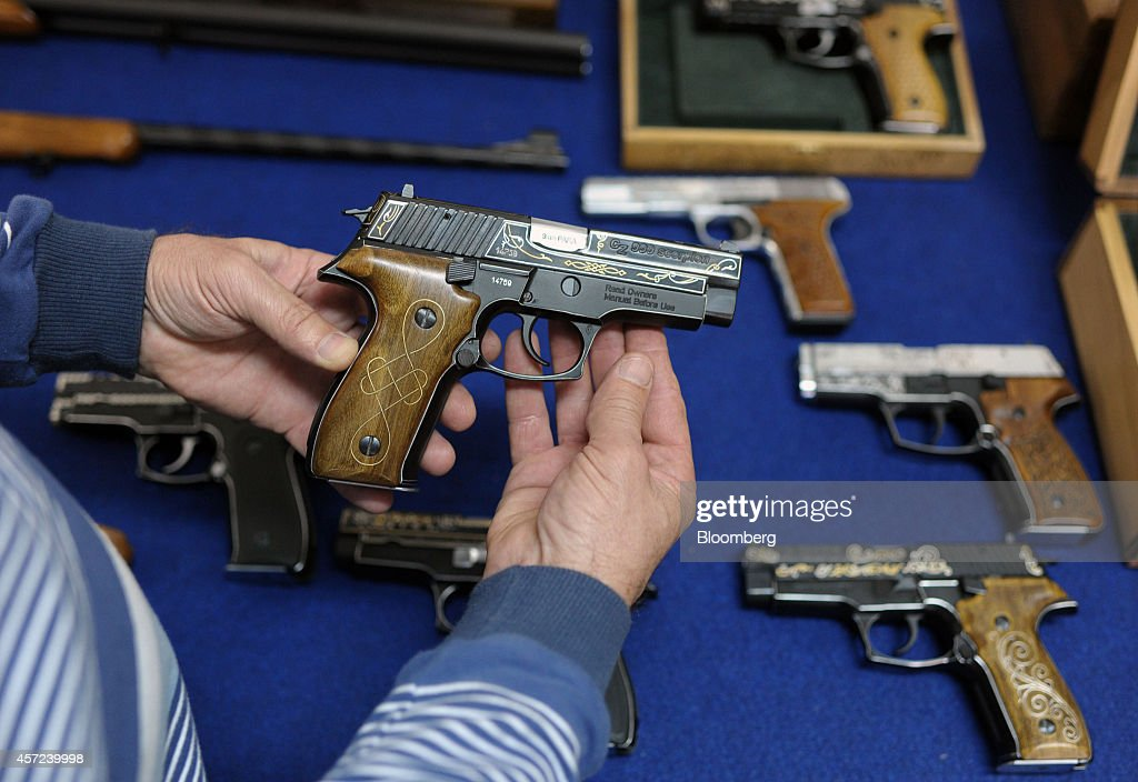 An employee holds a CZ999 Scorpion semiautomatic handgun manufactured by Zastava Arms at the Zastava Oruzje AD firearms factory in Kragujevac Serbia...