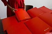 An employee holds a folder containing Banco Santander SA earnings figures at the bank's headquarters in Boadilla del Monte Spain on Wednesday July 27...