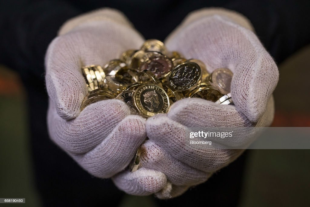 Behind The Scenes As Royal Mint Rolls Out Foolproof British One-Pound Coin : News Photo