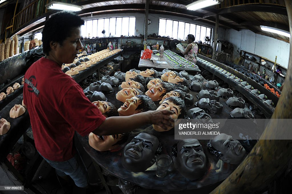 An employee holds a mask of Brazilian football star Neymar, at the carnival masks factory Condal, in Sao Gonçalo, about 35 km from downtown Rio de Janeiro, on January 9, 2013. Rio's world famous carnival takes place February 9-12.
