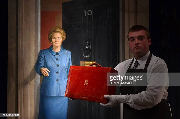 An employee holds a red Prime Ministerial dispatch box used by former British Prime Minister Margaret Thatcher and expected to realise £3000 5000 GPB...