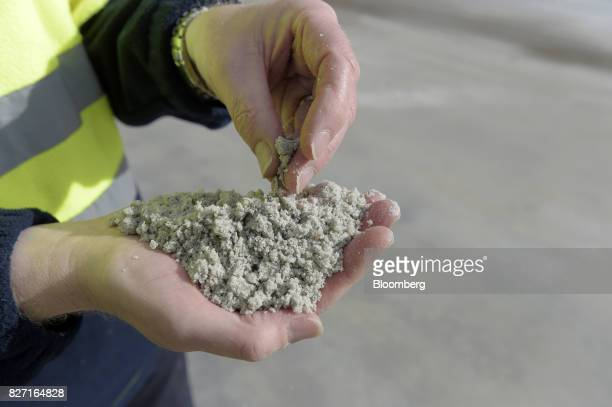 An employee holds processed lithium for a photograph at a Talison Lithium Ltd facility a joint venture between Tianqi Lithium Corp and Albemarle Corp...