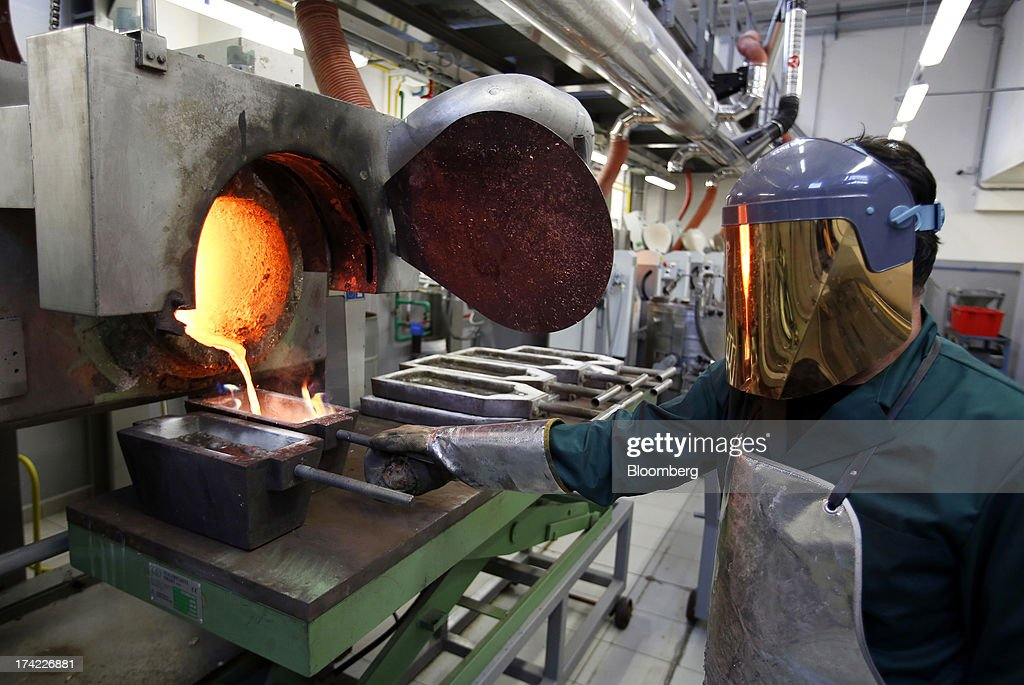 An employee in a protective heat suit pours molten gold from a furnace into a mould at the Italpreziosi SpA precious metals refinery plant in Arezzo, Italy, on Friday, July 19, 2013. Hedge funds raised bets on a gold rally before prices capped the biggest two-week gain in 20 months as Federal Reserve Chairman Ben S. Bernanke damped speculation that a cut in stimulus is imminent. Photographer: Alessia Pierdomenico/Bloomberg via Getty Images