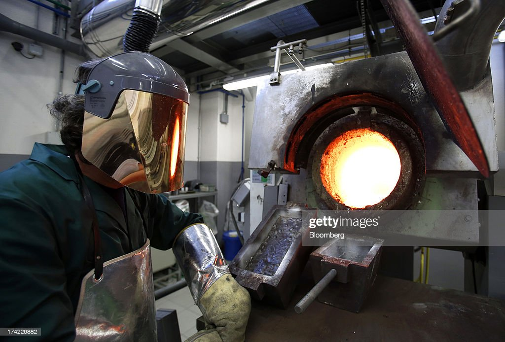 An employee in a protective heat suit works at the furnace for precious metals at the Italpreziosi SpA refinery plant in Arezzo, Italy, on Friday, July 19, 2013. Hedge funds raised bets on a gold rally before prices capped the biggest two-week gain in 20 months as Federal Reserve Chairman Ben S. Bernanke damped speculation that a cut in stimulus is imminent. Photographer: Alessia Pierdomenico/Bloomberg via Getty Images