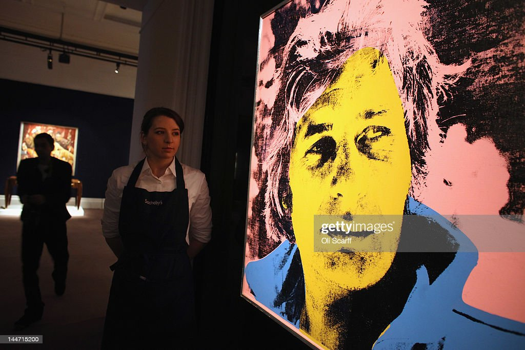 An employee in Sotheby's auction house views an artwork by Andy Warhol entitled 'Gunter Sachs' which is expected to fetch 600,000 GBP on May 18, 2012 in London, England. The artwork features in Sotheby's forthcoming sale from the collection of Gunter Sachs which is to be held on May 22 and 23, 2012 in London. The collection of over 300 works owned by the late husband of Brigitte Bardot is expected to fetch in excess of 20 million GBP.