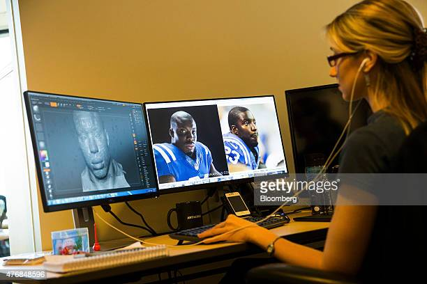 An employee in the Artworks department uses reference photos and scans to develop character art for video games at the Electronic Arts Inc Tiburon...