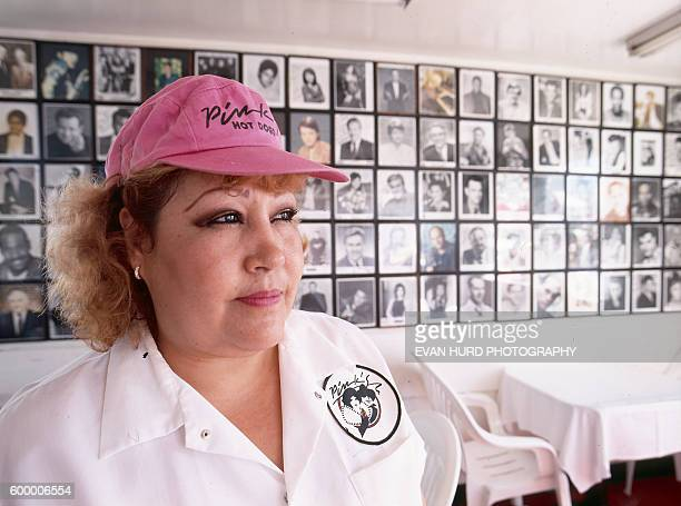 An employee in the inside dining area at Pink's hot dog stand at 709 N La Brea Avenue in Los Angeles The famous eatery was founded in 1939 and is...