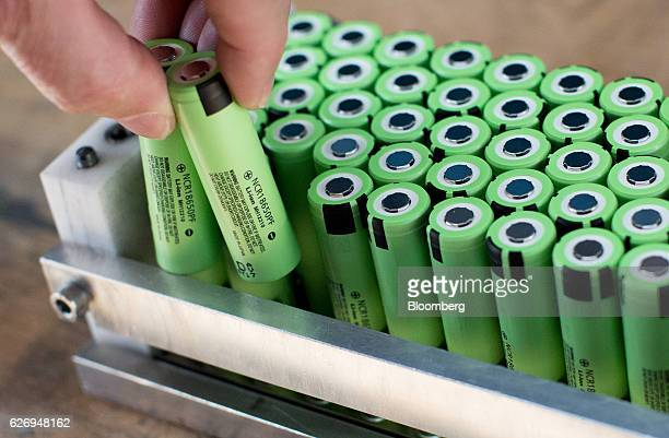 An employee inserts lithiumion battery cells during battery pack assembly at the Johammer emobility GmbH electric motorbike factory in Bad Leonfelden...