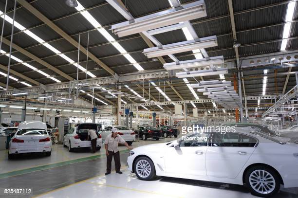 An employee inspects a BMW sedan at a PT Gaya Motor plant in Jakarta Indonesia on Wednesday Aug 2 2017 BMW is scheduled to report secondquarter...