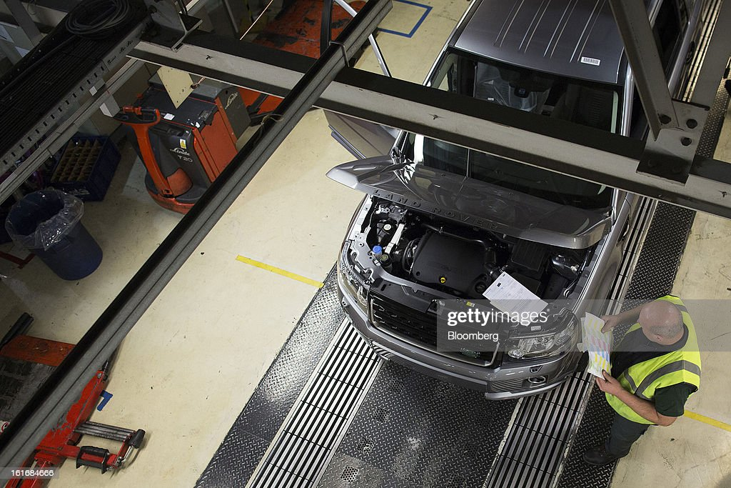An employee inspects a completed Land Rover Freelander 2 SUV automobile, produced by Jaguar Land Rover Plc, a unit of Tata Motors Ltd., as it travels along the production line at the company's assembly plant in Halewood, U.K., on Wednesday, Feb. 13, 2013. Carmakers from Ford Motor Co. to Audi AG and Jaguar Land Rover Plc are using record amounts of aluminium to replace heavier steel, providing relief to producers of the metal confronting excess supplies and depressed prices. Photographer: Simon Dawson/Bloomberg via Getty Images
