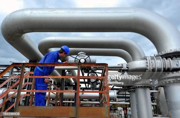 An employee inspects a pipeline valve at the INA Industrije Nafte dd oil refinery in Urinj near Rijeka Croatia on Thursday May 23 2013 Croatia whose...