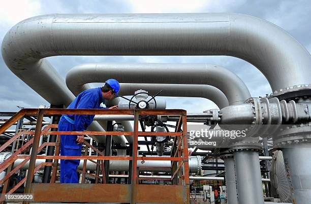 An employee inspects a pipeline valve at the INA Industrije Nafte dd oil refinery in Urinj near Rijeka Croatia on Thursday May 23 2013 Croatia whose...
