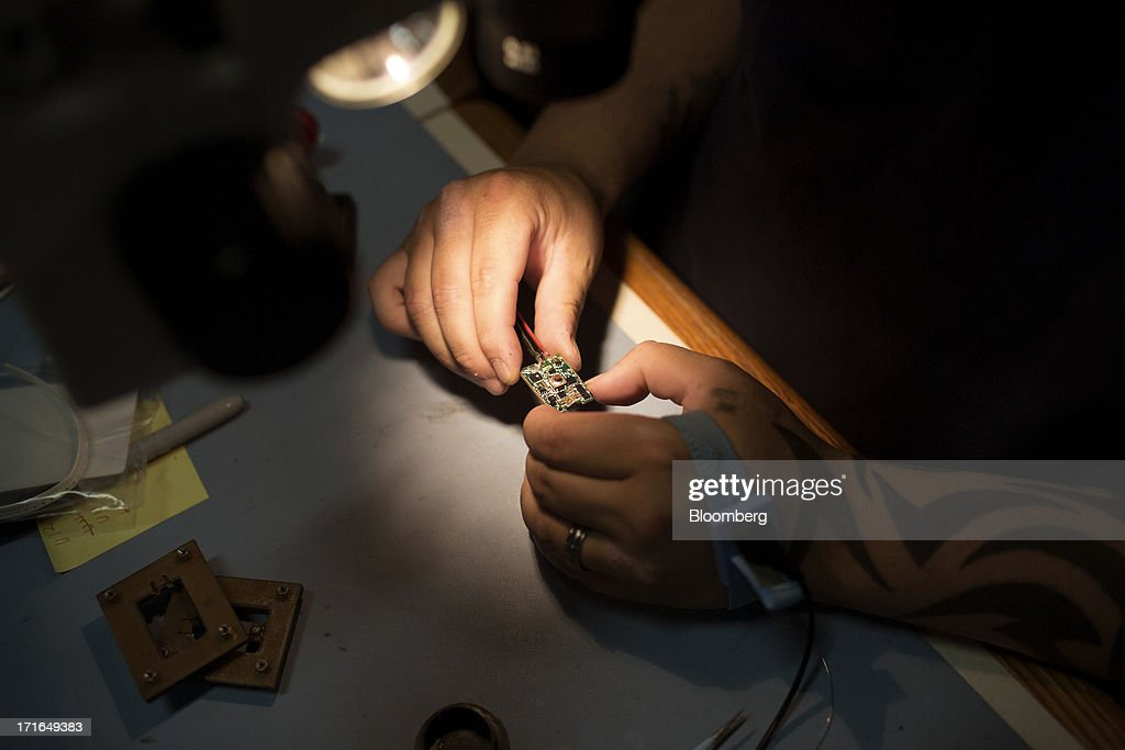 An employee inspects a ProVari model electronic cigarette circuit board for manufacturing errors at the ProVape Inc. facility in Monroe, Washington, U.S., on Wednesday, June 26, 2013. U.S. sales of electronic cigarettes are estimated to double in 2013 from last year, to $1 billion, according to estimates made by the Tobacco Merchants Association (TMA) and Mintel. Photographer: Mike Kane/Bloomberg via Getty Images