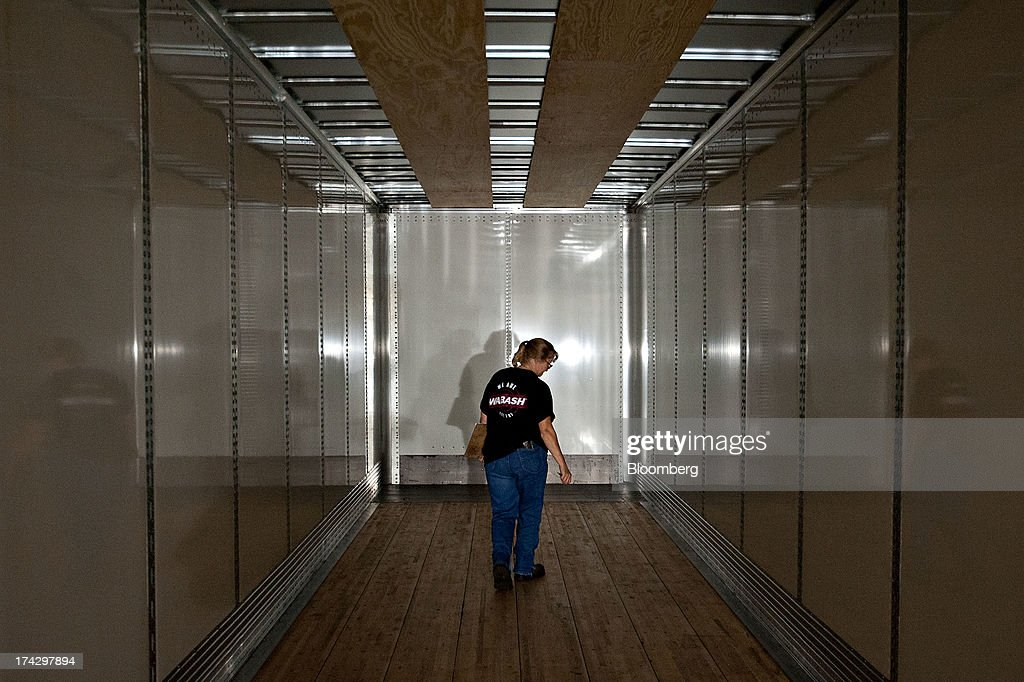 An employee inspects a recently completed semi trailer at the Wabash National Corp. facility in Lafayette, Indiana, U.S., on Monday, July 22, 2013. Wabash National Corp. is scheduled to release earnings figures on July 30. Photographer: Daniel Acker/Bloomberg via Getty Images