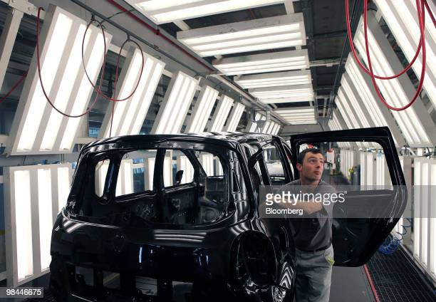 An employee inspects a Renault SA vehicle on the production line at the Renault factory in Valladolid Spain on Tuesday April 13 2010 Renault SA and...