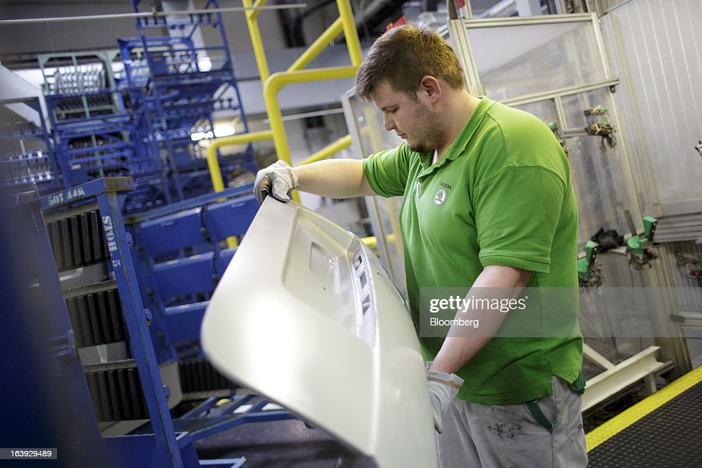 An employee inspects an automobile body part before assembly at the Skoda Autos AS plant in Mlada Boleslav, Czech Republic, on Friday, March 15, 2013. VW, which also owns the Porsche luxury-auto brand as well as the Skoda and Seat volume marques, will build at least 10 plants globally, including seven in China, Martin Winterkornm chief executive officer of Volkswagen AG, said. Photographer: Martin Divisek/Bloomberg via Getty Images