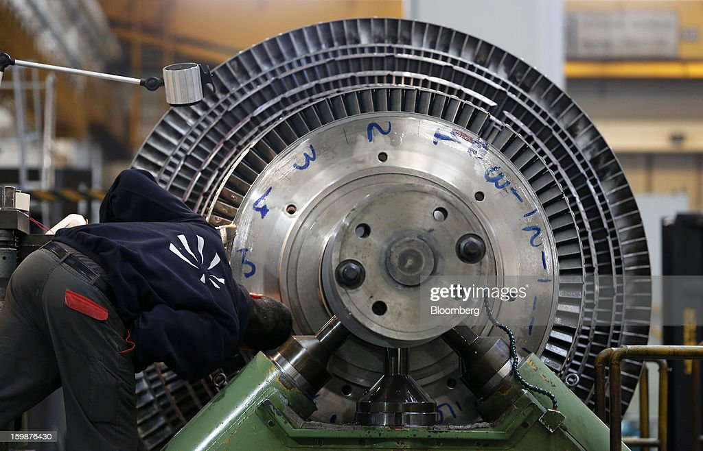 An employee inspects components on a steam turbine rotor shaft at Ansaldo Energia SpA's power-plant production facility in Genoa, Italy, on Friday, Jan. 18, 2013. Finmeccanica SpA is seeking binding bids for assets, including a majority stake in Ansaldo Energia, by Jan. 23, while a final decision will be made at a later board meeting, Ansa reported Jan. 16. Photographer: Alessia Pierdomenico/Bloomberg via Getty Images