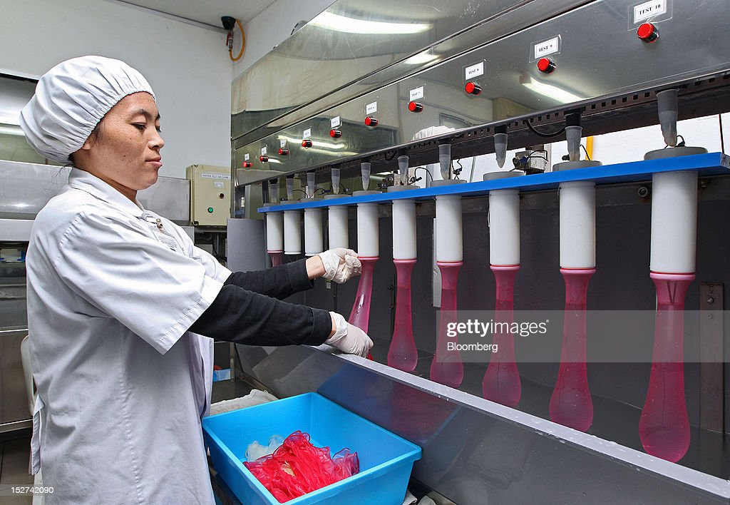 An employee inspects condoms during testing in the research laboratory at the Karex Industries Sdn. Bhd. condom factory in Pontian Besar, Johor, Malaysia, on Thursday, Sept. 20, 2012. Karex Industries' line of business includes the manufacturing of industrial rubber goods, rubberized fabrics, and miscellaneous rubber specialties. Photographer: Goh Seng Chong/Bloomberg via Getty Images