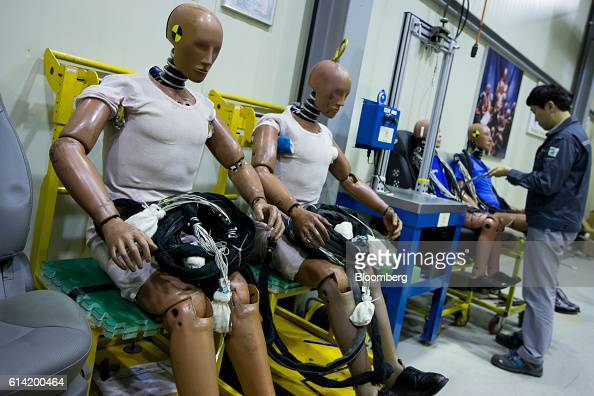 An employee inspects crash test dummies at the Korea Automobile Insurance Repair Research and Training Center operated by the Korea Insurance...