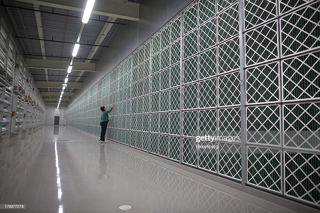 An employee inspects equipment in the air filter room inside Facebook Inc.'s new data storage center near the Arctic Circle in Lulea, Sweden, on Wednesday, June 12, 2013. The data center is Facebook's first outside the U.S., poised to handle all data processing from Europe, Middle East and Africa and the server hub is largest of its kind in Europe, and most northerly of its magnitude anywhere on earth. Photographer: Simon Dawson/Bloomberg via Getty Images