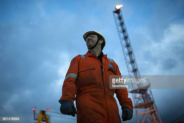 An employee inspects the helicopter landing pad in view of a gas burn off venting pipe on the Armada gas condensate platform operated by BG Group Plc...
