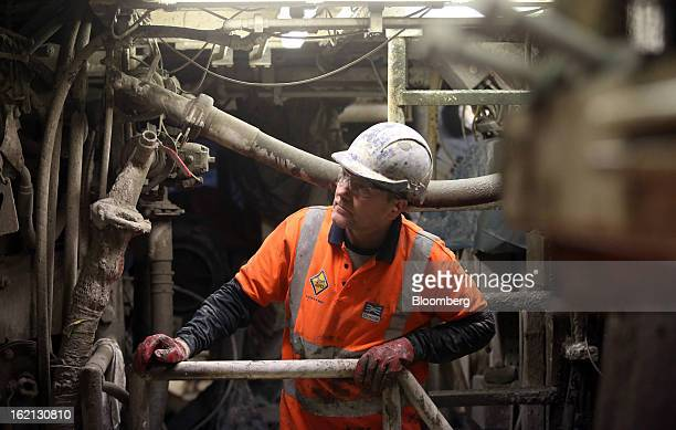 An employee inspects the perimeter wall of one of the new western tunnels developed by Crossrail beneath London UK on Tuesday Feb 19 2013 Network...