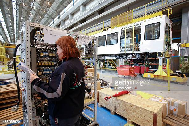 An employee inspects the stock levels of electronic components during train carriage manufacturing at AnsaldoBreda SpA's rail car plant in Naples...