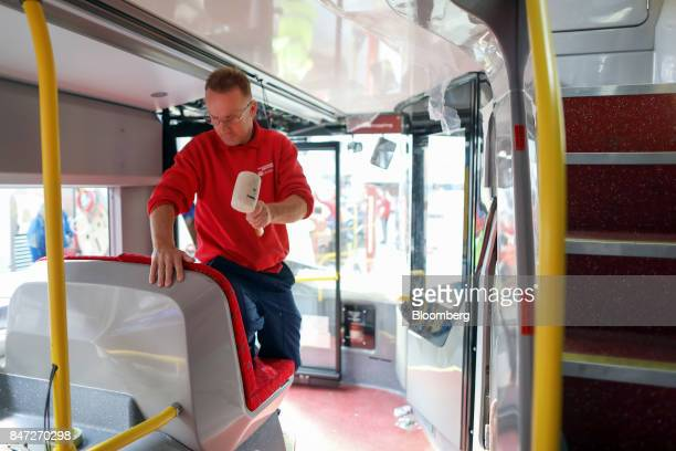 An employee installs a seat at the front of an Enviro 400 London bus at the Alexander Dennis Ltd factory in Scarborough UK on Wednesday Sept 13 2017...
