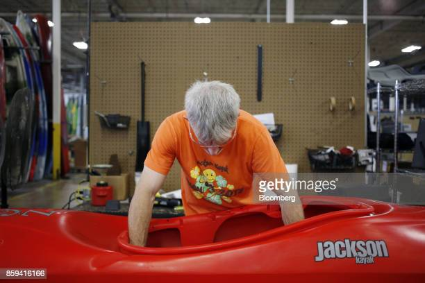 An employee installs hardware onto a plastic kayak at the Jackson Kayak Inc factory in Sparta Tennessee US on Wednesday Oct 4 2017 Durable goods...
