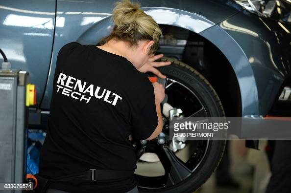 an employee is at work to build converted vehicles at renault tech workshop in french carmaker. Black Bedroom Furniture Sets. Home Design Ideas