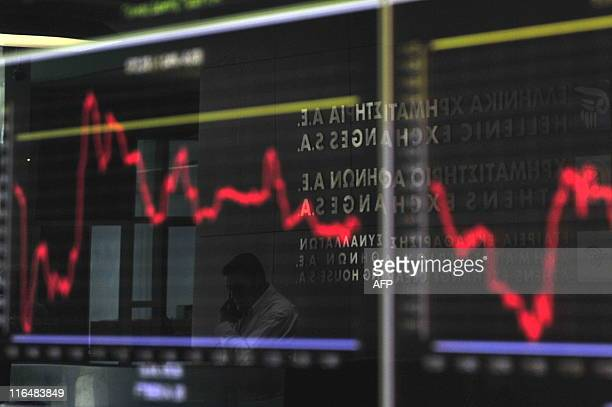 An employee is reflected in a electronic index display at the Hellenic Exchanges on June 2 2011 Greece came under intense pressure Wednesday from all...