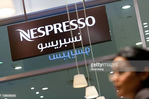 An employee is seen inside a Nestle SA Nespresso coffee boutique in Dubai Mall Dubai United Arab Emirates on Tuesday Jan 25 2011 Nespresso's...