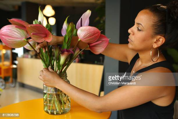 An employee is tying a bouquet during the 'Kians Garden Flower Shop' Opening Event at Kantstrasse on July 11 2017 in Berlin Germany