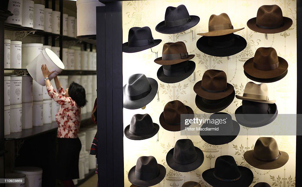 An employee lifts down a hatbox at Lock Co Hatters on March 22 2011 in London England Founded in St James's in 1676 when Charles II was on the throne...