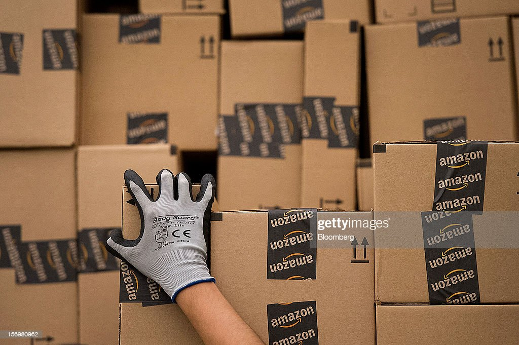 An employee loads a truck with boxes to be shipped at the Amazon.com Inc. distribution center in Phoenix, Arizona, U.S. on Monday, Nov. 26, 2012. U.S. retailers are extending deals into Cyber Monday and beyond to try to sustain a 13 percent gain in Thanksgiving weekend sales. Photographer: David Paul Morris/Bloomberg via Getty Images