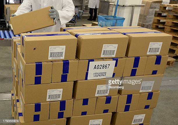 An employee loads boxes of meatfree Quorn products manufactured by Quorn Foods a unit of Exponent Private Equity LLP onto a pallet ahead of shipping...