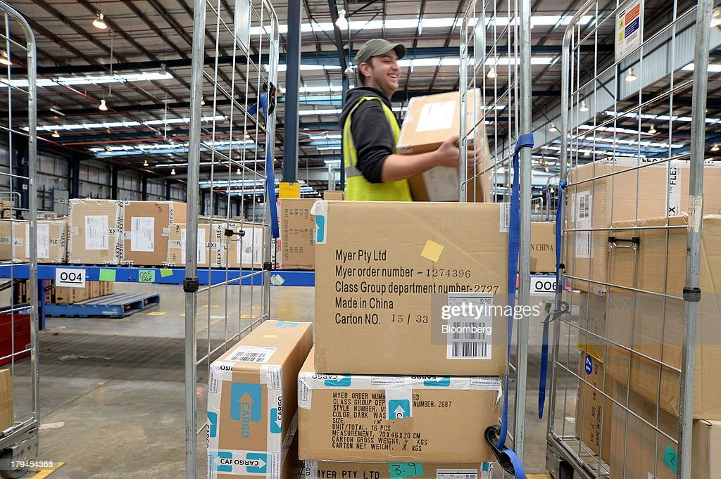 An employee loads boxes of merchandise onto a trolley at the Myer Holdings Ltd. distribution center in Melbourne, Australia, on Tuesday, Sept. 3, 2013. A Bureau of Statistics report released in Sydney on Sept. 4 showed household spending climbed 0.4 percent in the second quarter, adding 0.2 percentage point to gross domestic product growth. Photographer: Carla Gottgens/Bloomberg via Getty Images