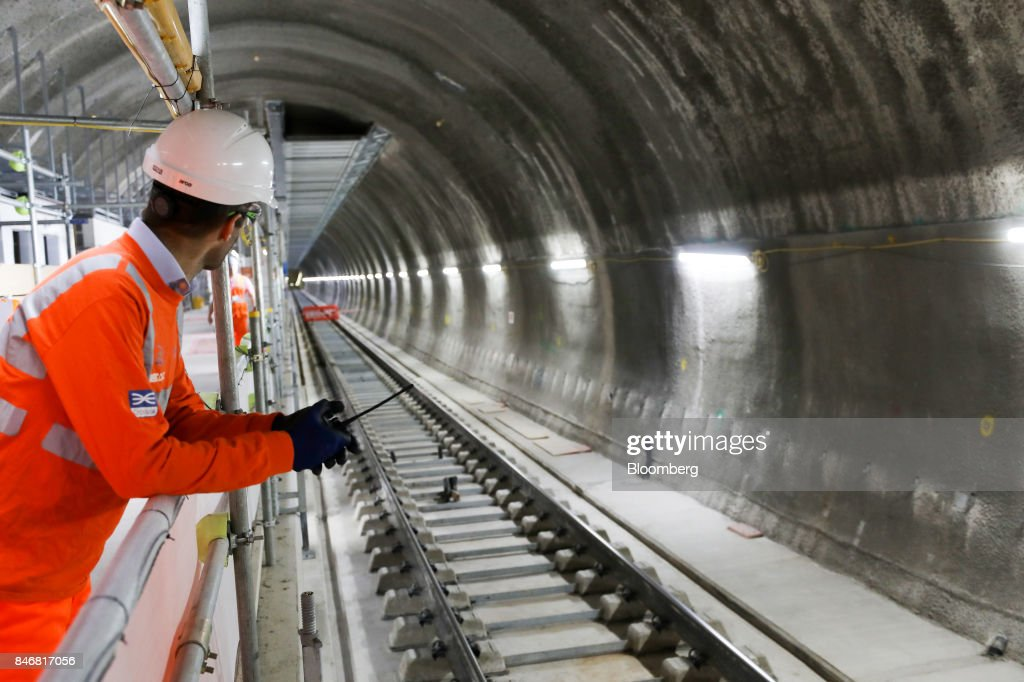 An employee looks along a section of Crossrail Ltd. track in a tunnel near Whitechapel station during an event to celebrate the completion of the permanent track on the Elizabeth line in London, U.K., on Thursday, Sept. 14, 2017. Crossrail, which will be known as the Elizabeth Line once its up and running, hasnt yet set fares, but transit agency Transport for London has indicated they will be significantly less than Heathrow Express with a charging structure more akin to the Tube. Photographer: Chris Ratcliffe/Bloomberg via Getty Images