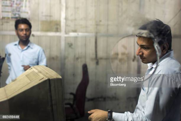 An employee looks at a computer monitor inside a ticketing office at Gwalior Railway Station in Gwalior Madhya Pradesh India on Wednesday May 31 2017...