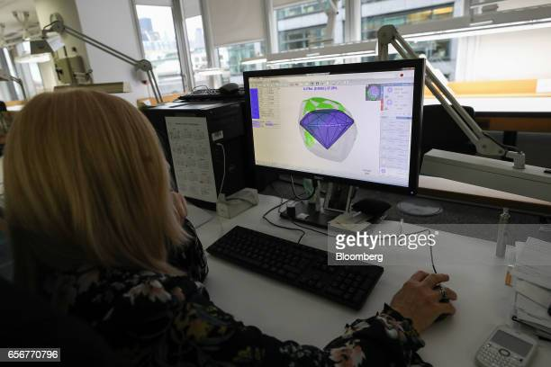 An employee looks at a scan of a diamond on a computer at the De Beers SA headquarters on Charterhouse Street in London UK on Wednesday Feb 1 2017...
