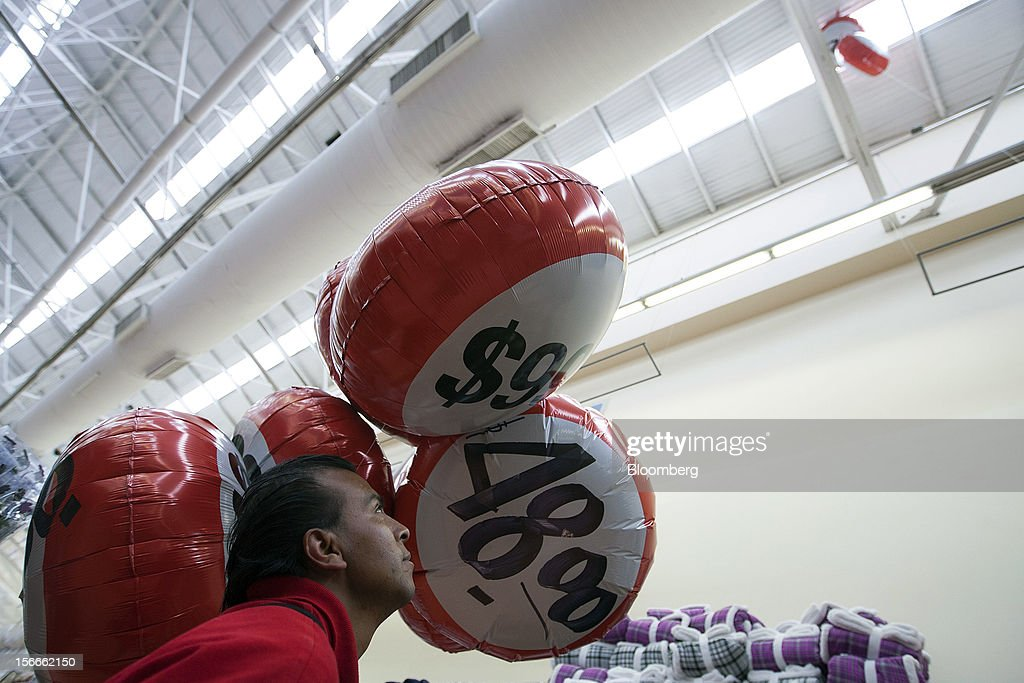 An employee looks at balloons marked with discount specials inside a Wal-Mart de Mexico SAB de CV in Mexico City, Mexico on Saturday, Nov. 17, 2012. El Buen Fin, Mexico's equivalent of Black Friday, when the year's biggest discounts are offered by participating stores, is held on the third weekend of November and will run through Nov. 19. Photographer: Susana Gonzalez/Bloomberg via Getty Images