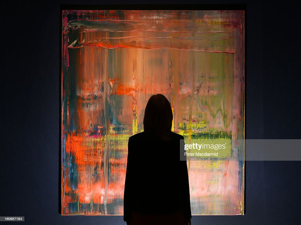 An employee looks at Gerhard Richter's 'Abstraktes Bild' ahead of their Post War and Contemporary art sale on February 8, 2013 in London, England. Christie's will hold an evening sale of these works on February 13, 2013 and a day sale on February 14, 2013.